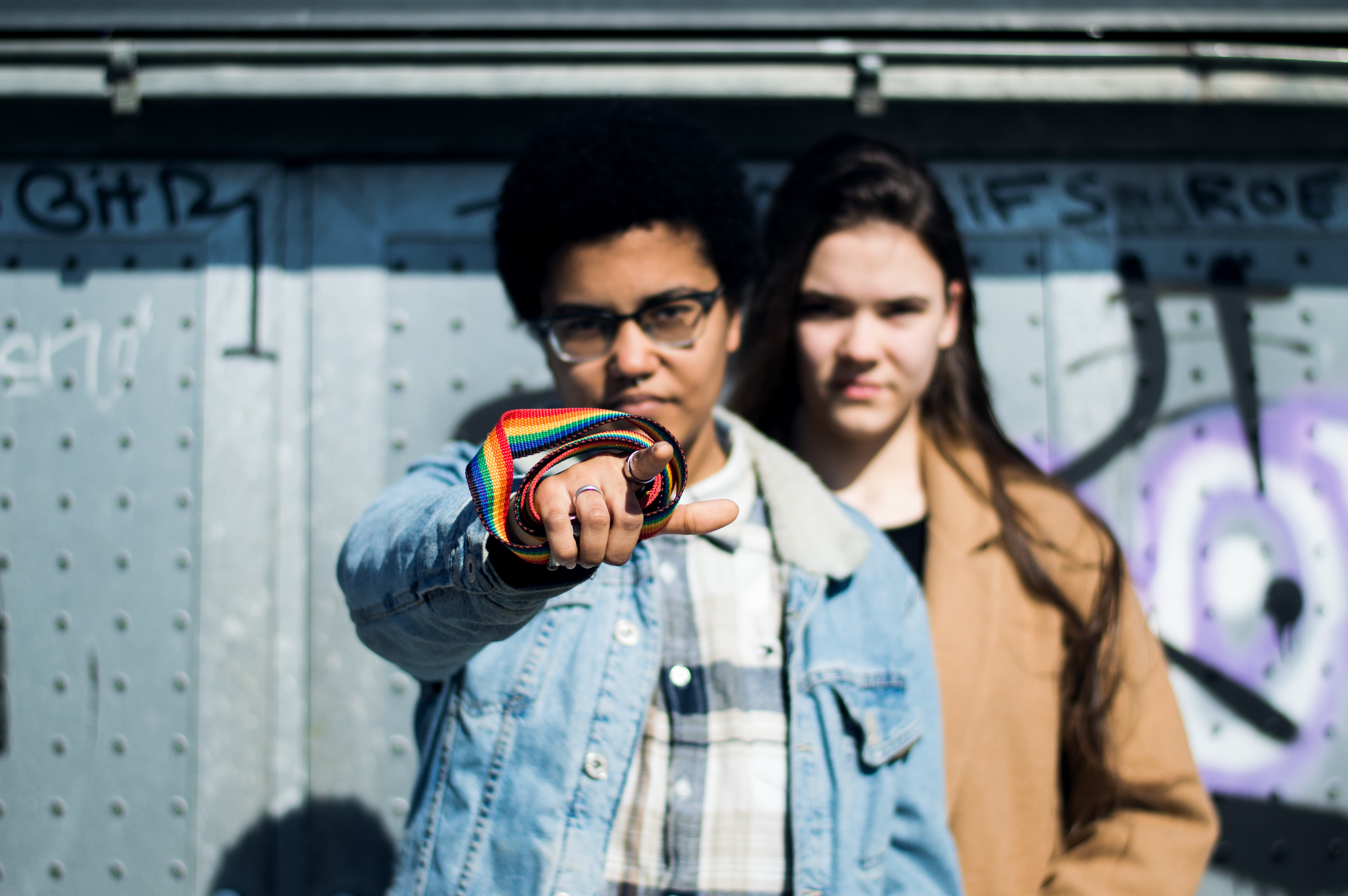 Two girls with rainbow lanyard