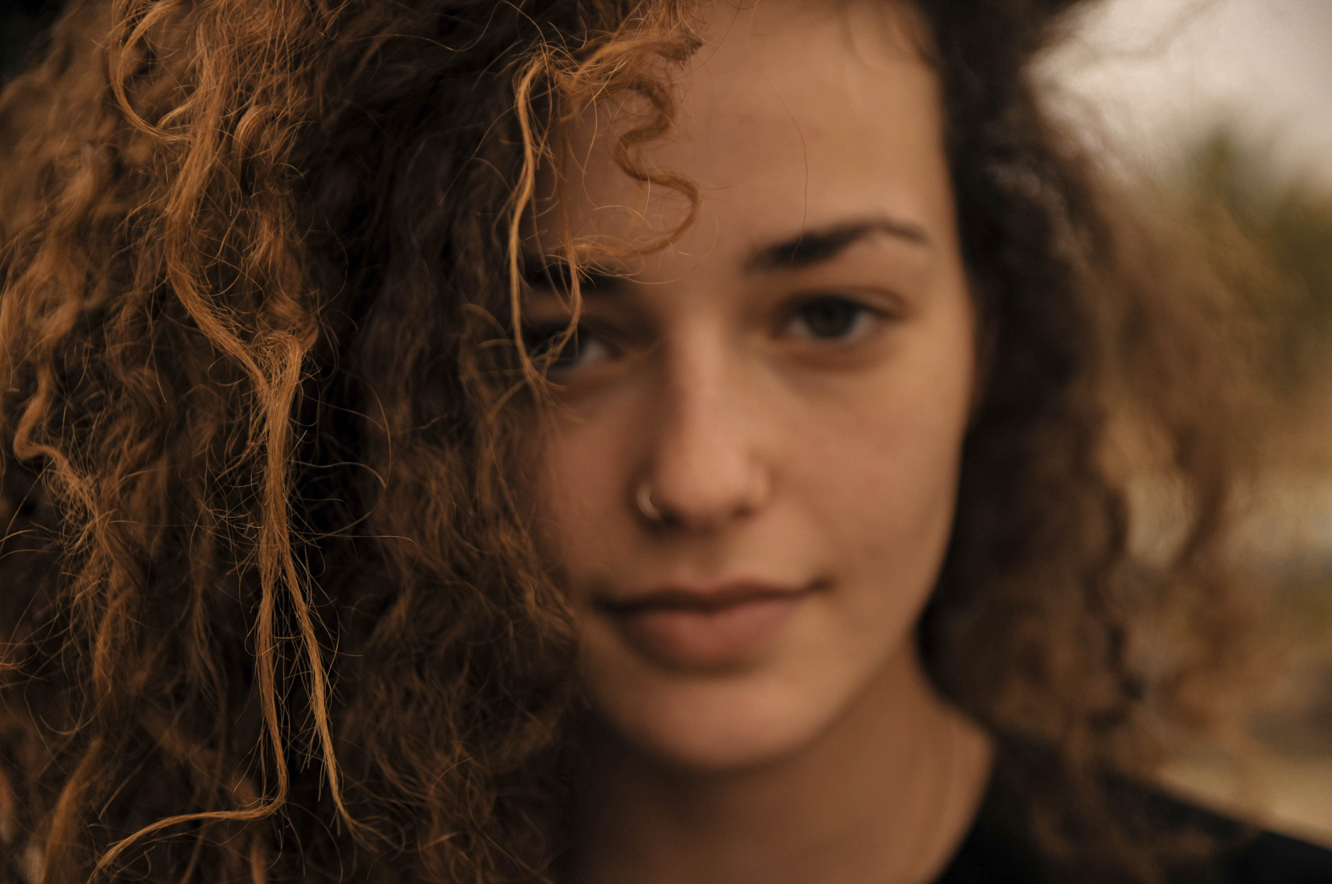 Up close portrait of girl with curly hair