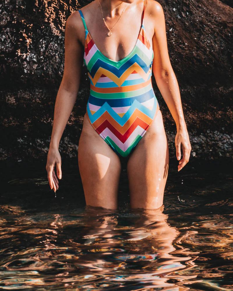 woman standing in water in bathing suit