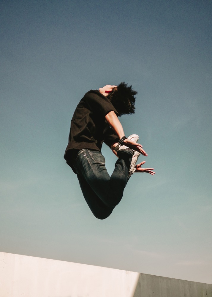 Man jumping for joy on a sunny day