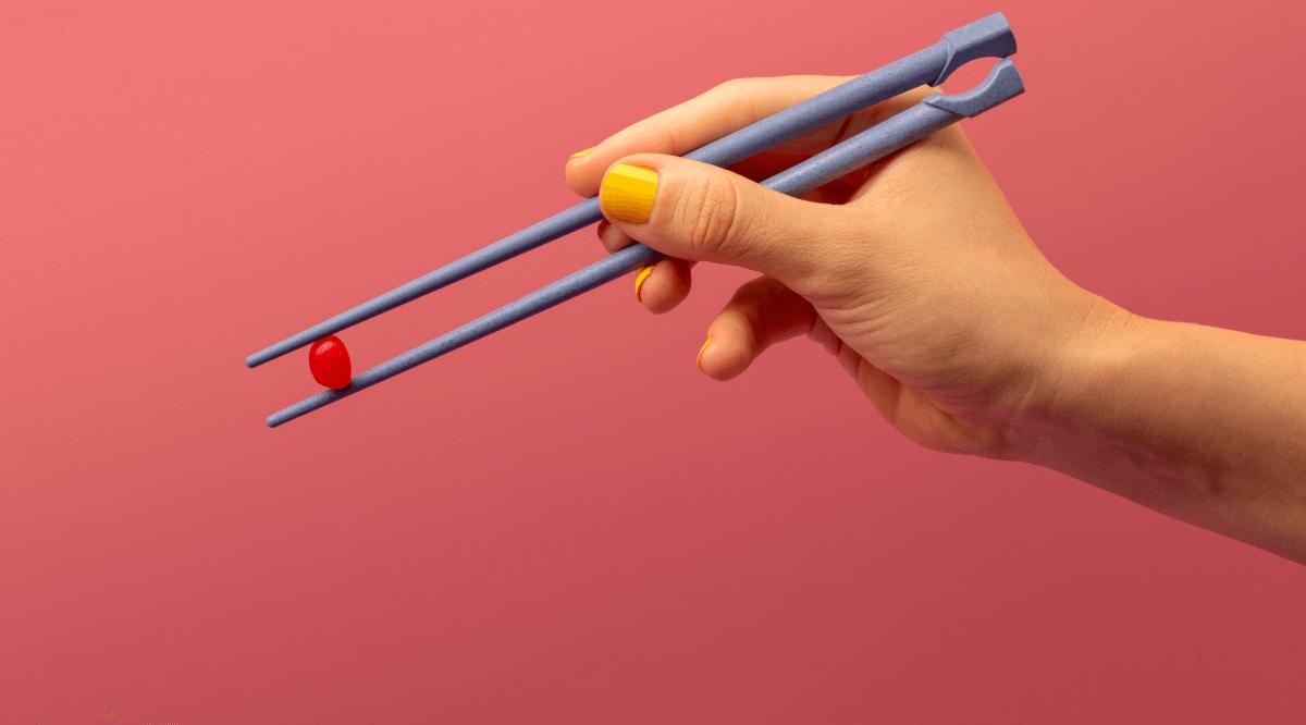 Close up of chopsticks holding a jelly bean