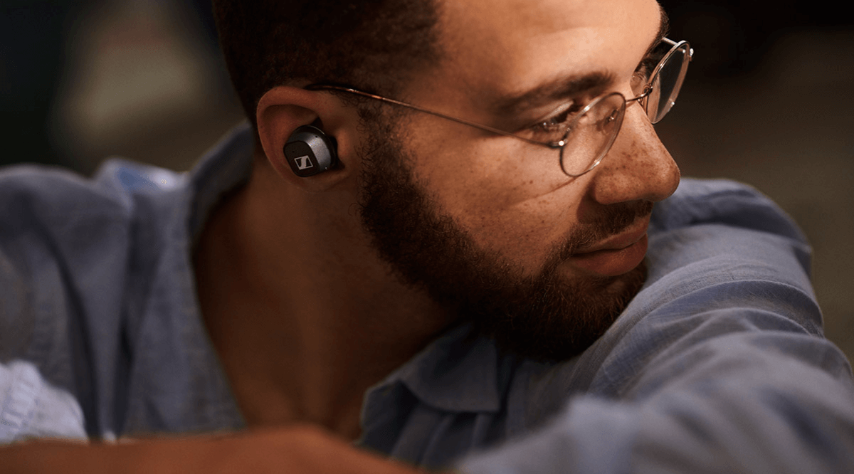 Man listening to music on Sennheiser headphones