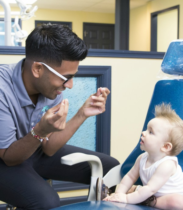 Doctor playing baby at Sea of Smiles Pediatric Dentistry