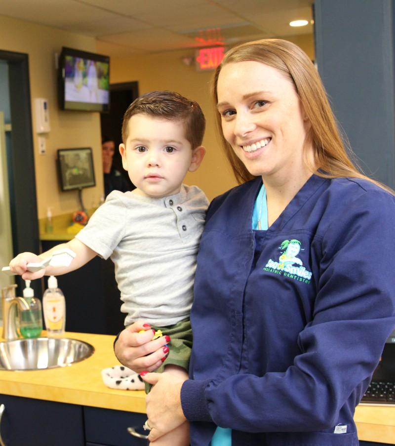 Staff member holding child