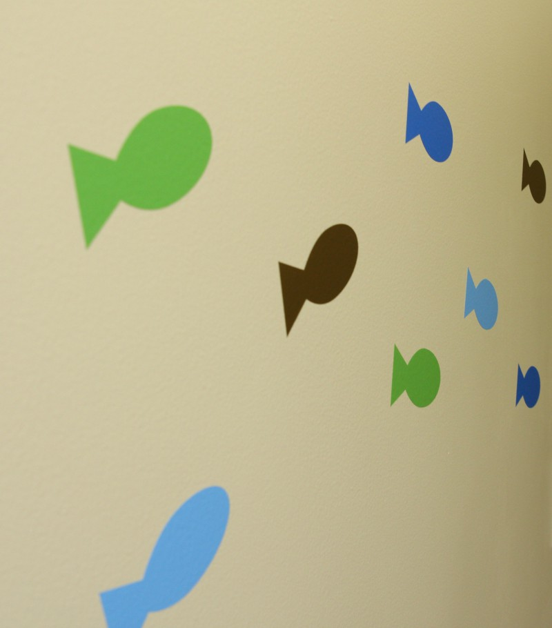 stickers of fish on the wall at Sea of Smiles Pediatric Dentistry