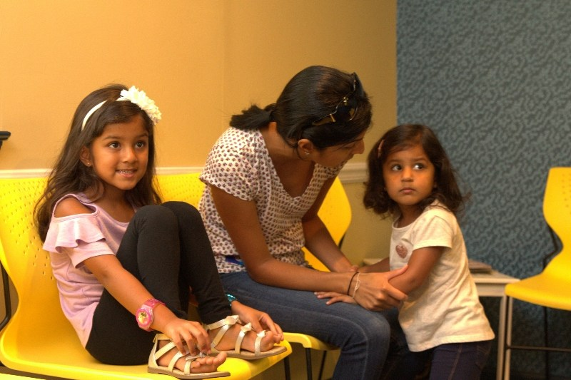 family in waiting room at Sea of Smiles Pediatric Dentistry