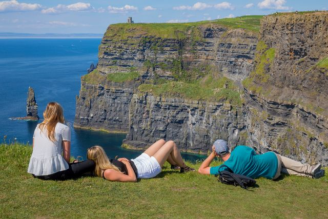 Admiring the rock strata at the Cliffs of Moher