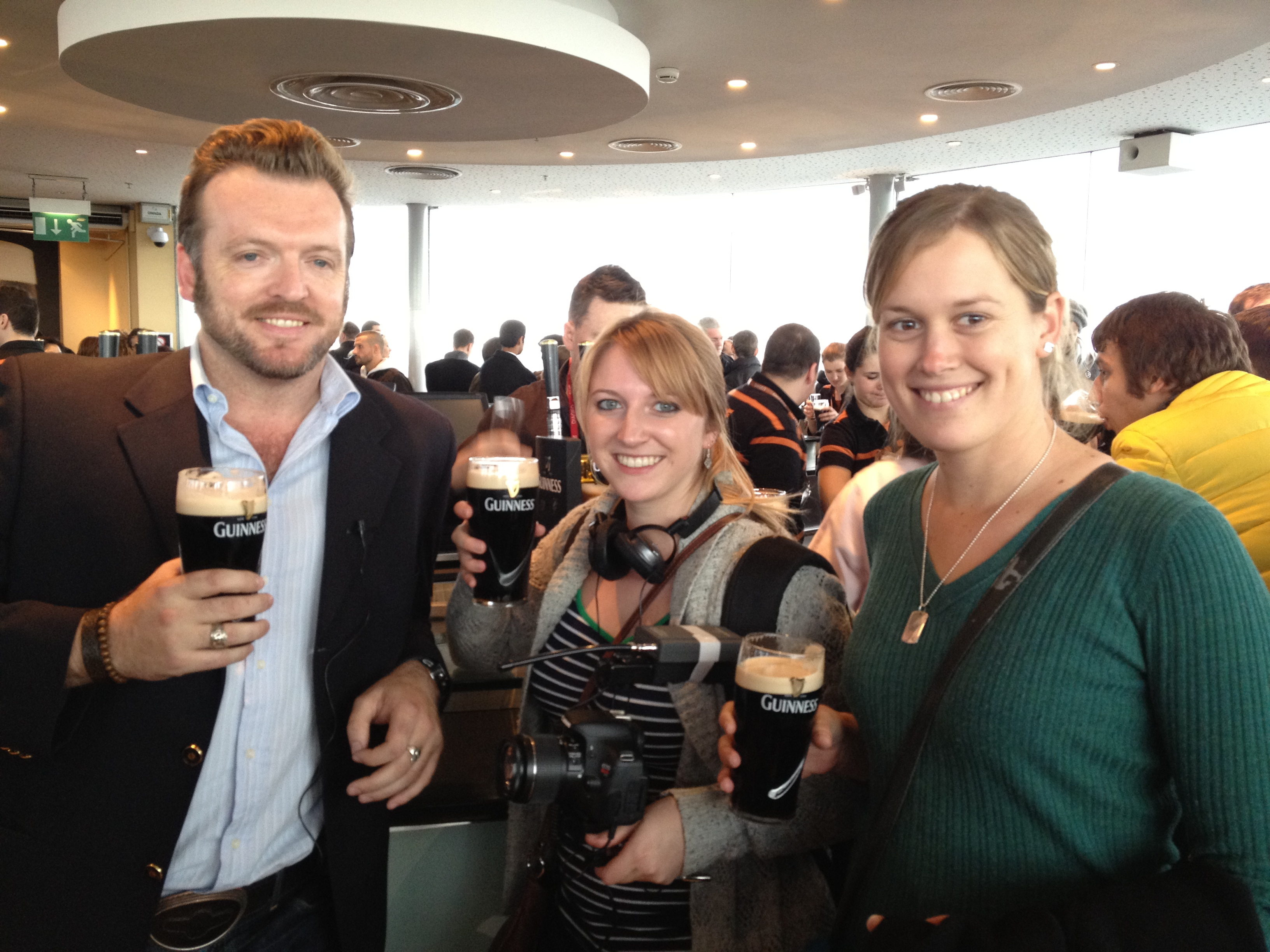 Essential Ireland tour guests having a pint of Guinness with chief guide Stephen McPhilemy