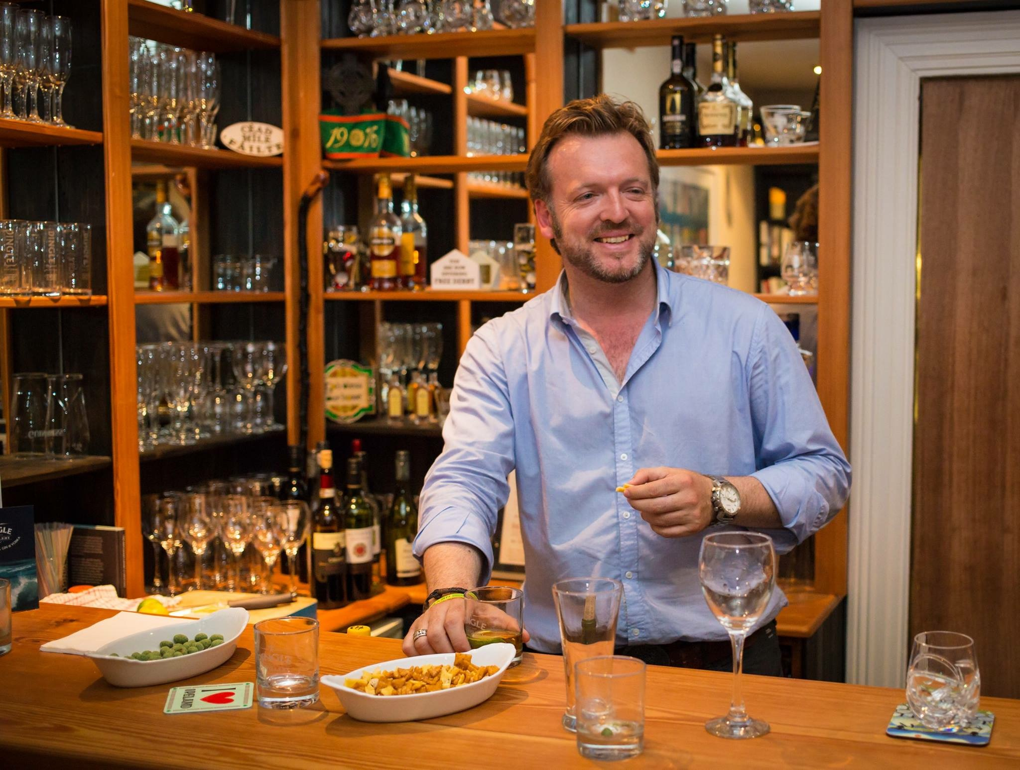 Essential Ireland Tour's chief guide Stephen McPhilemy, behind the bar at Milltown House in Dingle, Ireland