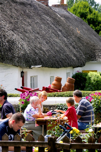 Essential Ireland tour guests enjoying a cottage lunch in beautiful Adare in the sun