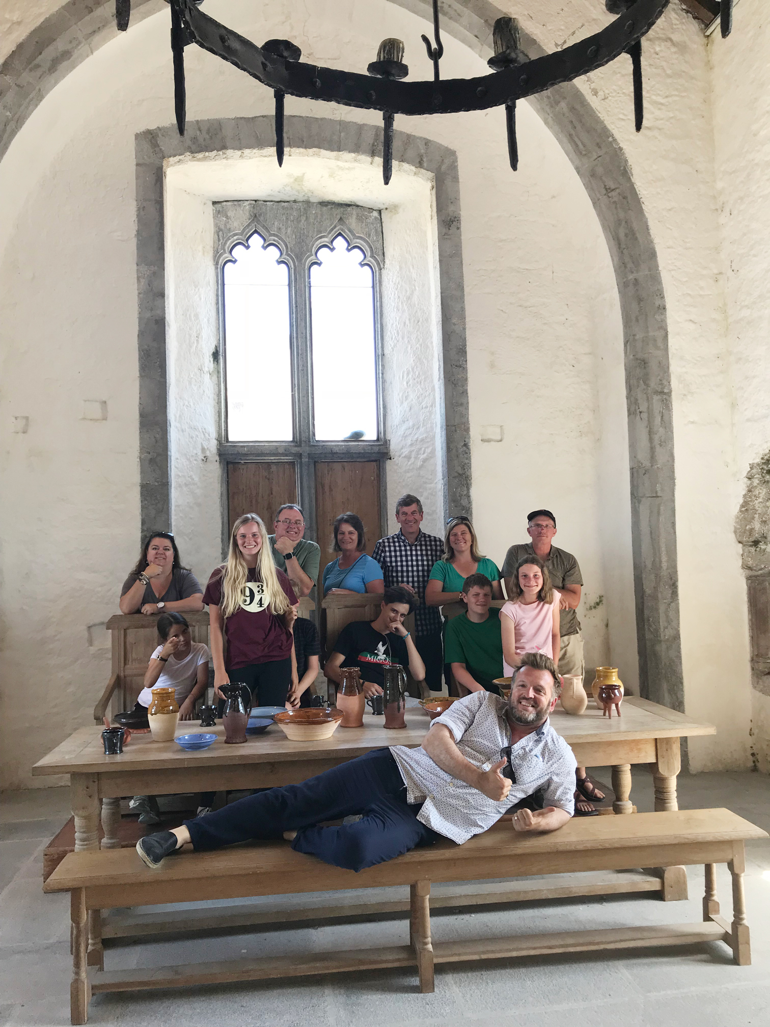 Chief guide Stephen McPhilemy and Essential Ireland tour group in the Great Hall of the Fitzgeralds in Newcastlewest in Limerick