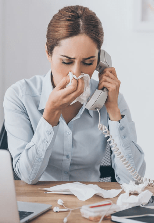 Woman with allergies on the phone