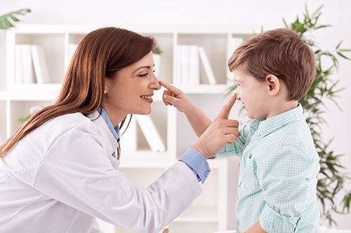 Nurse caring for child with allergies