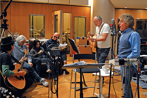 Roger Daltrey in the studio with fellow musicians.