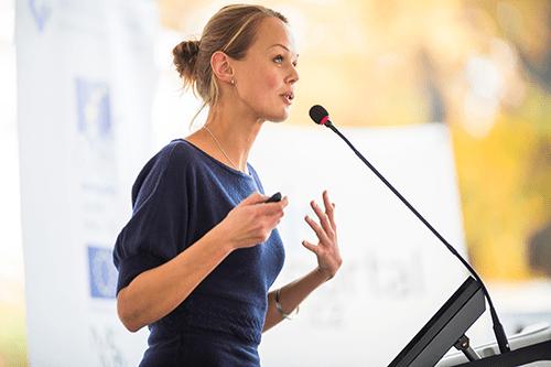 Professor using her voice to teach a class.
