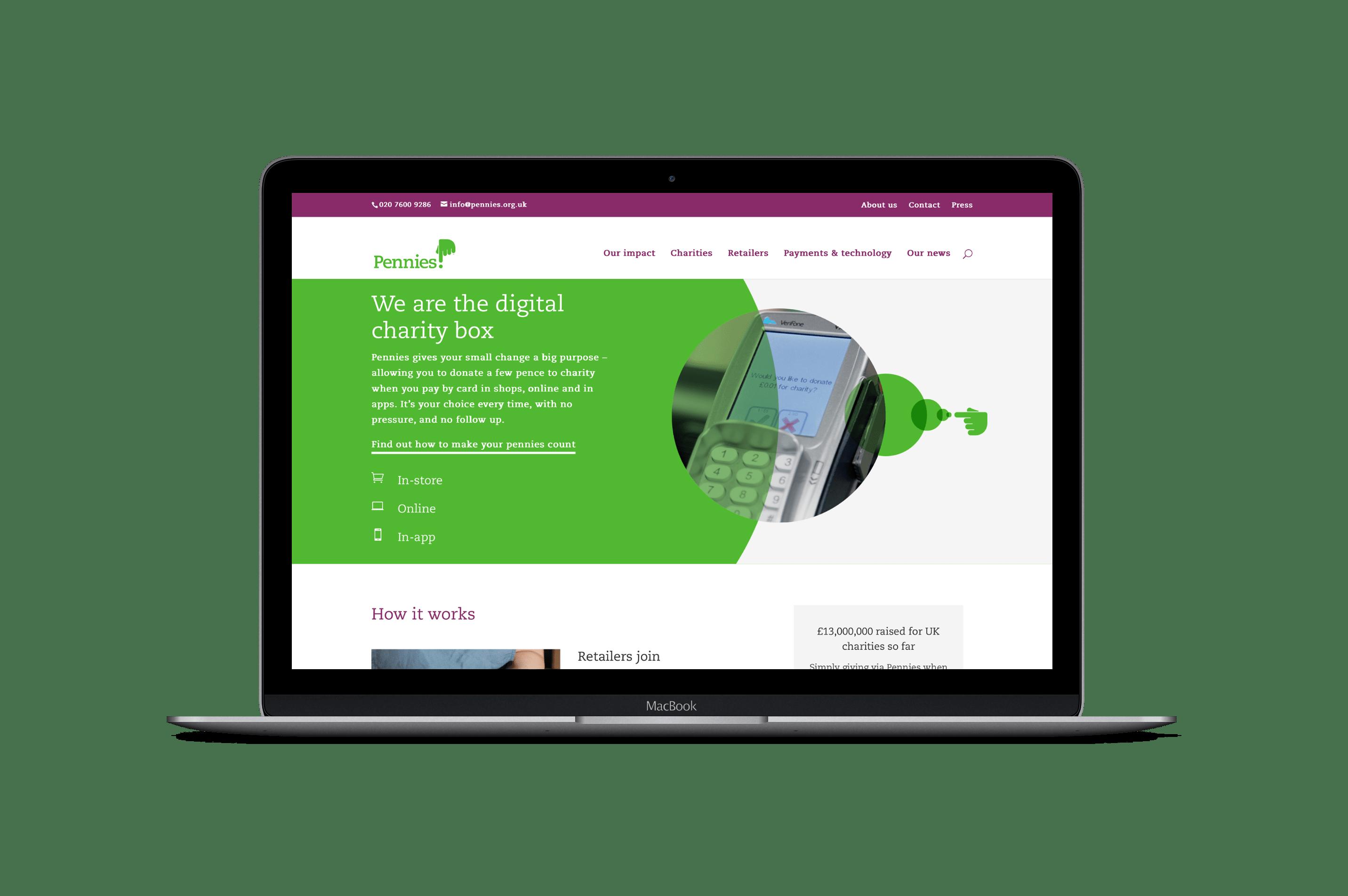 Pennies website homepage displayed on MacBook laptop