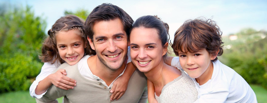 Happy couple with a complete family choosing to have a no-needle, no-scalpel vasectomy.