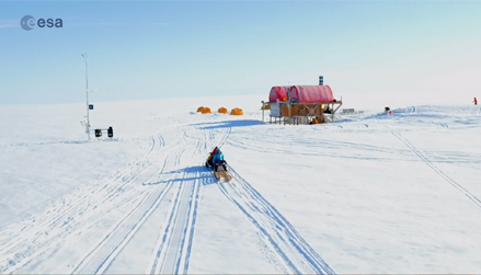 A screenshot from a course video showing a sled in Greenland