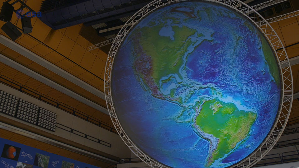 A picture of a large Earth globe model