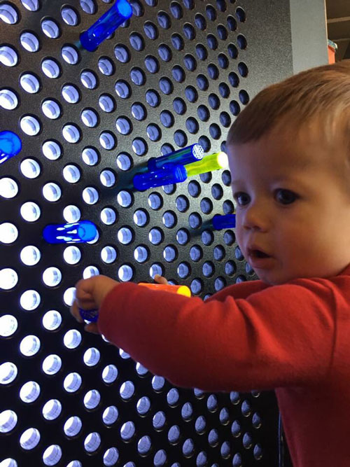 Giant light bright wall with toddler playing