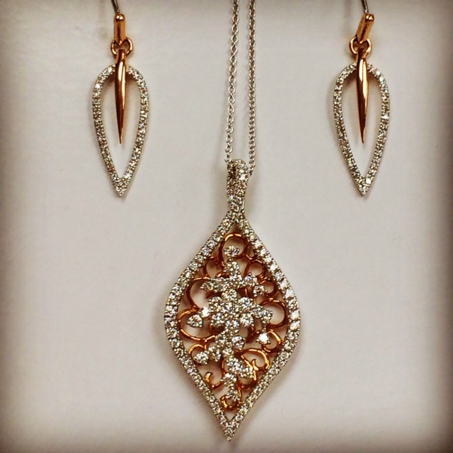 lisa kotchey jewelry, a pendant and earrings