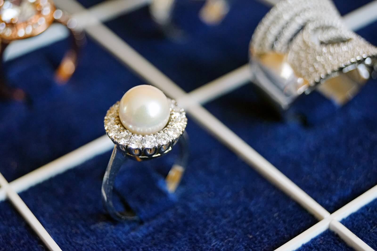 pearl and diamond ring in a box