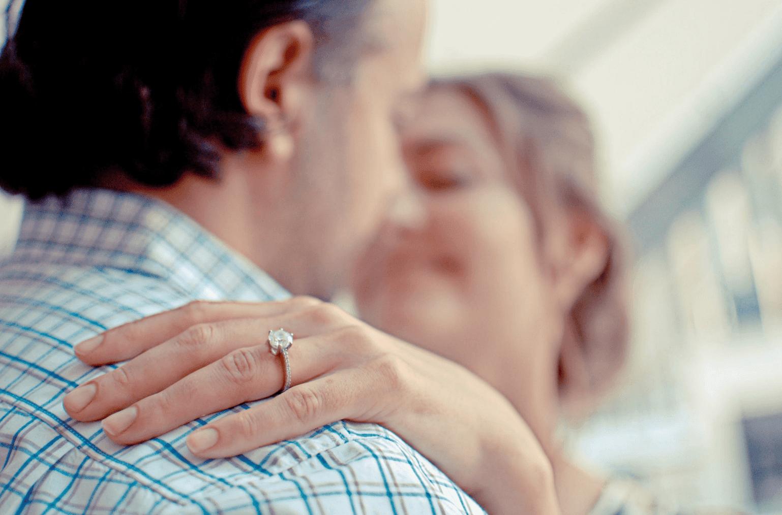 diamond ring on woman's finger