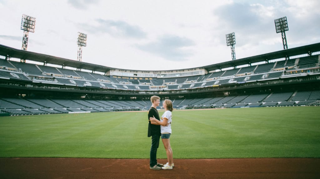 young boy and girl in a stadium