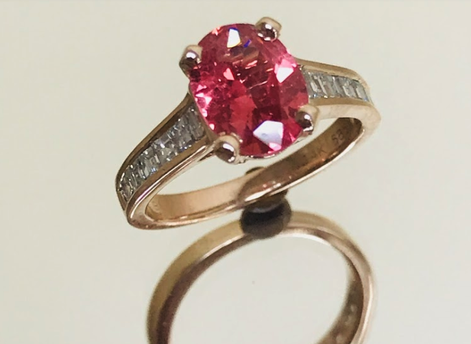 ring with rose colored gem