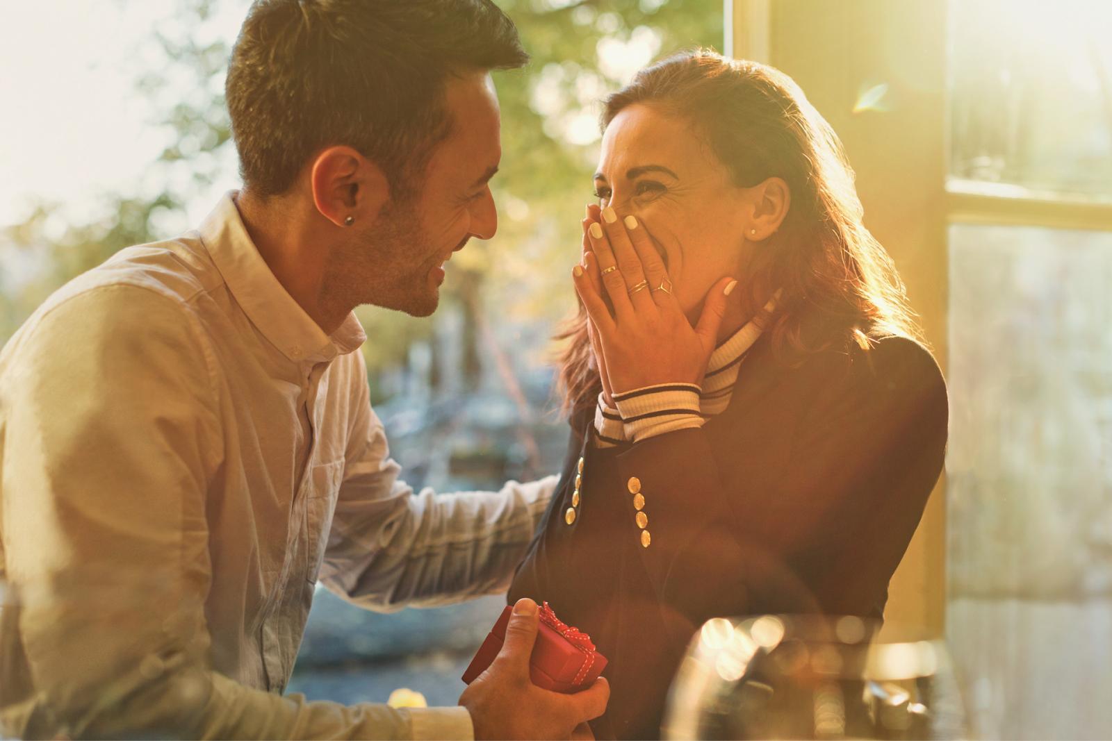 man proposing to happy girlfriend