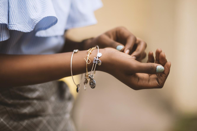woman adjusting her bracelets