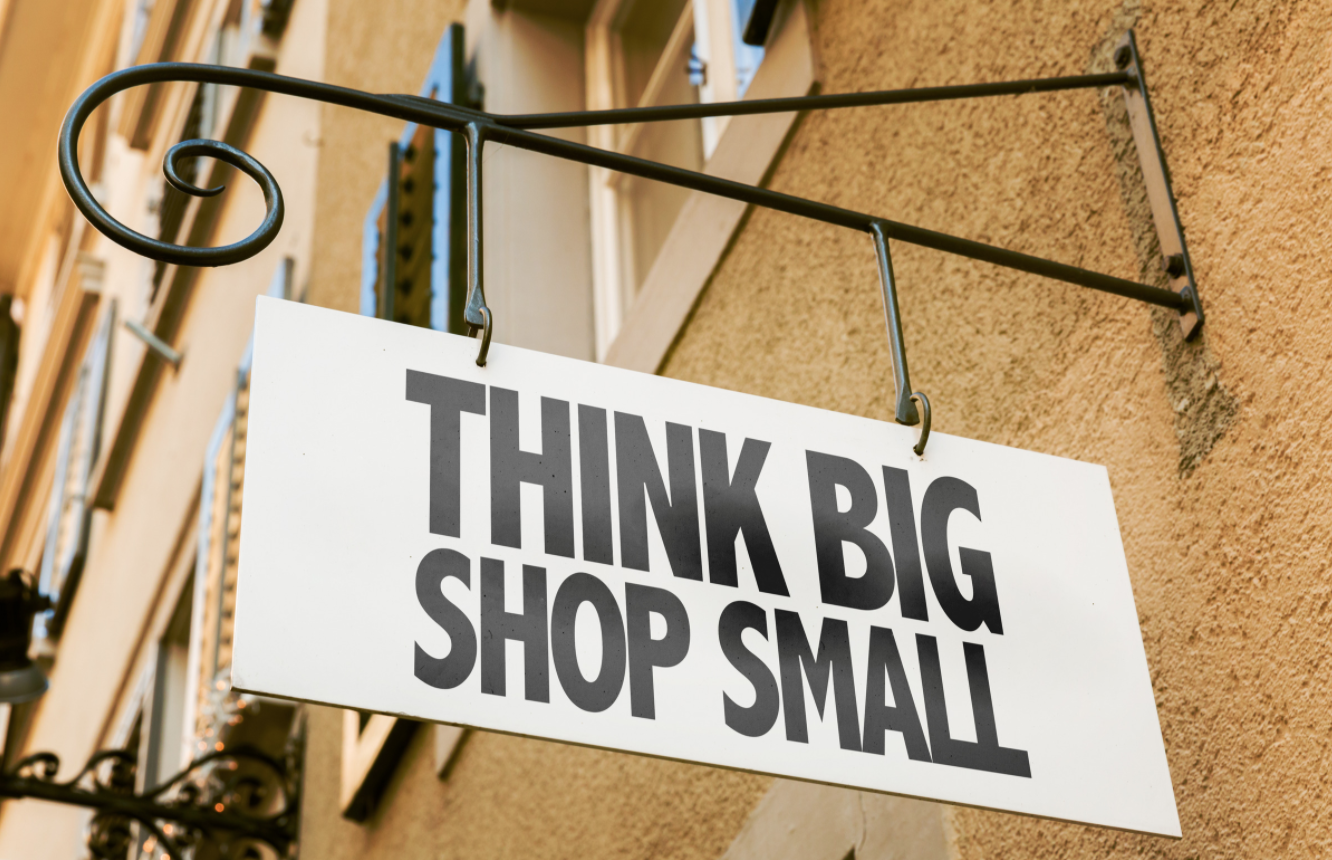"shop sign that says ""Think big, shop small"""