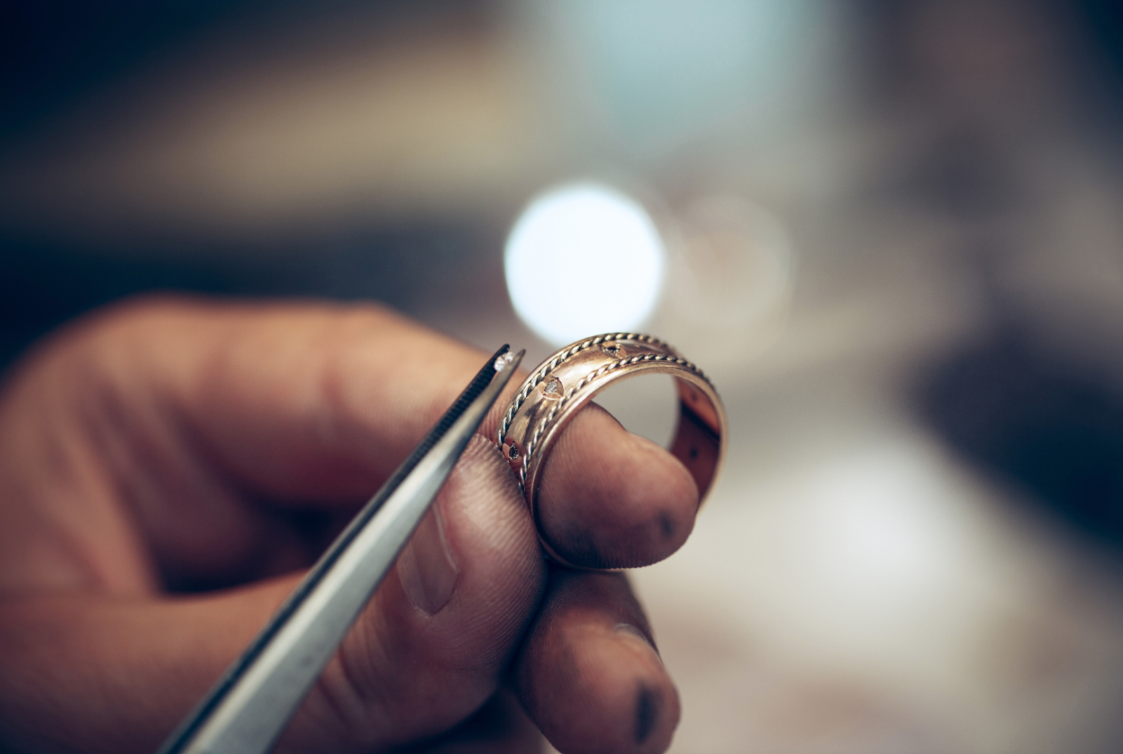 close-up of person creating a custom ring