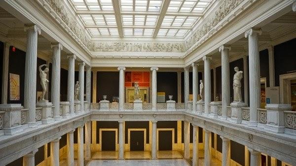 room full of greek statues in the carnegie museum of art