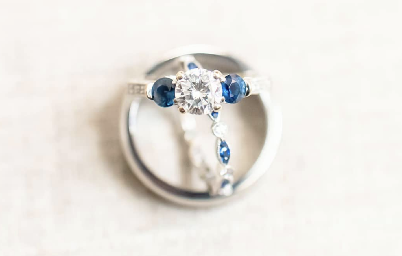 small engagement ring with silver band and blue gems