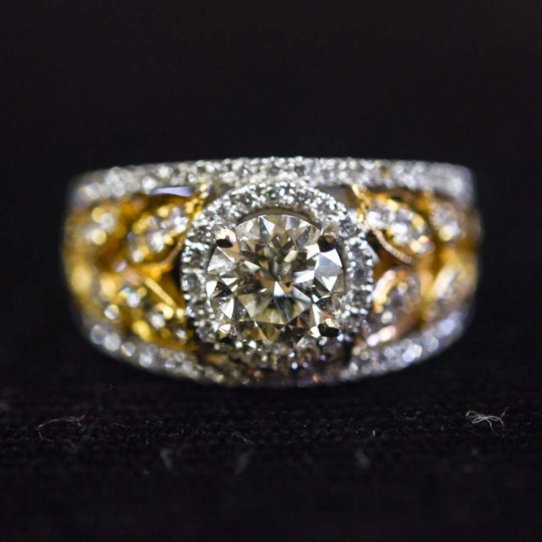 bold engagement ring with diamonds and gold band