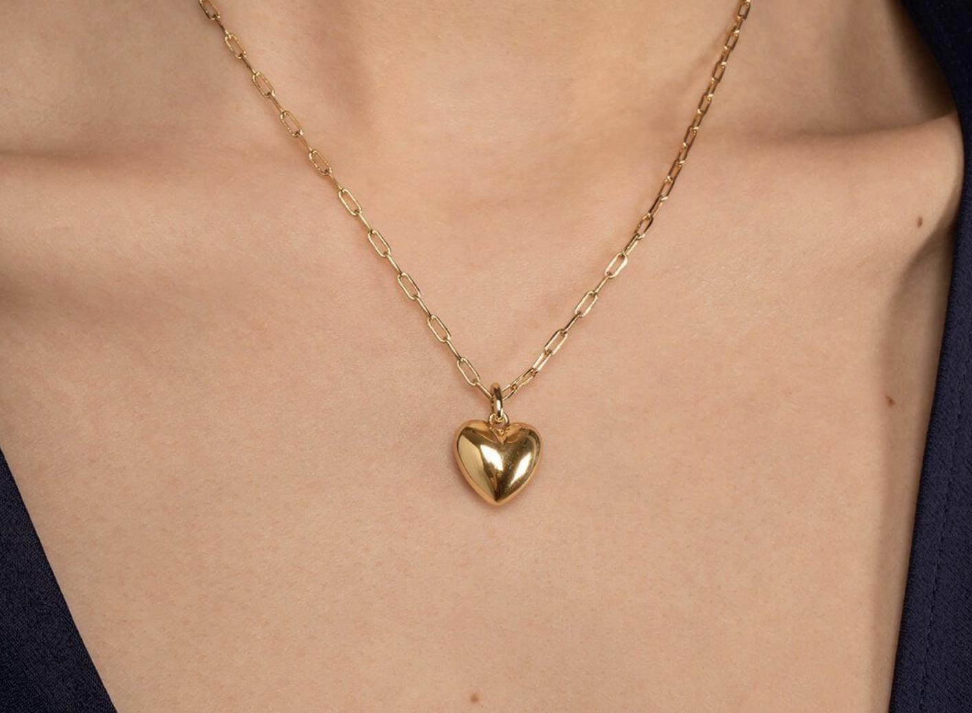 woman wearing gold pendant