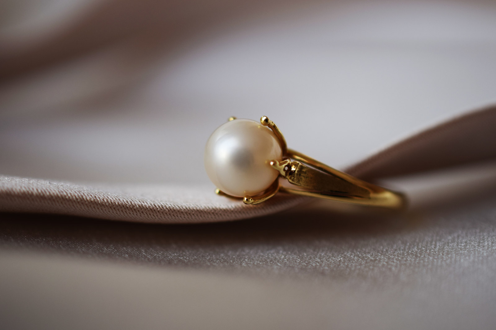 Close Up Of Gold Ring With Pearl