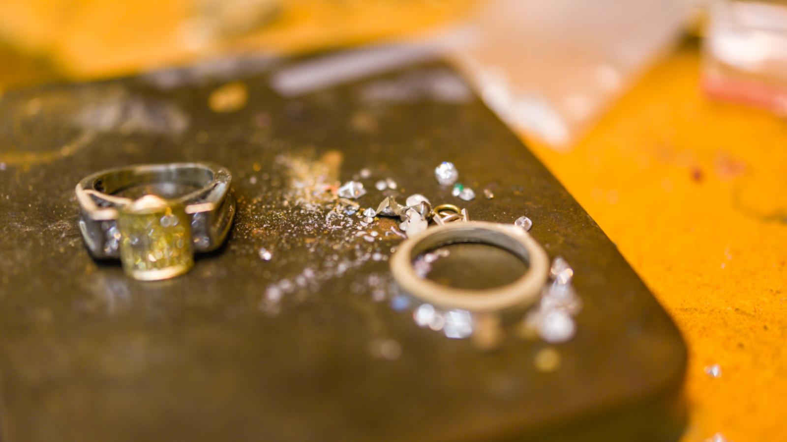 closeup of two custom wedding rings by Lisa Marie Kotchey