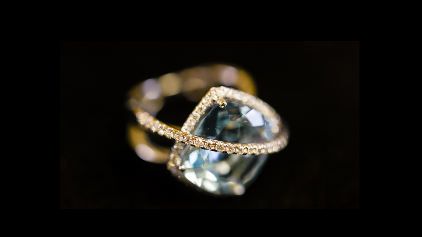closeup of ring handcrafted by Lisa Marie Kotchey with a dark background