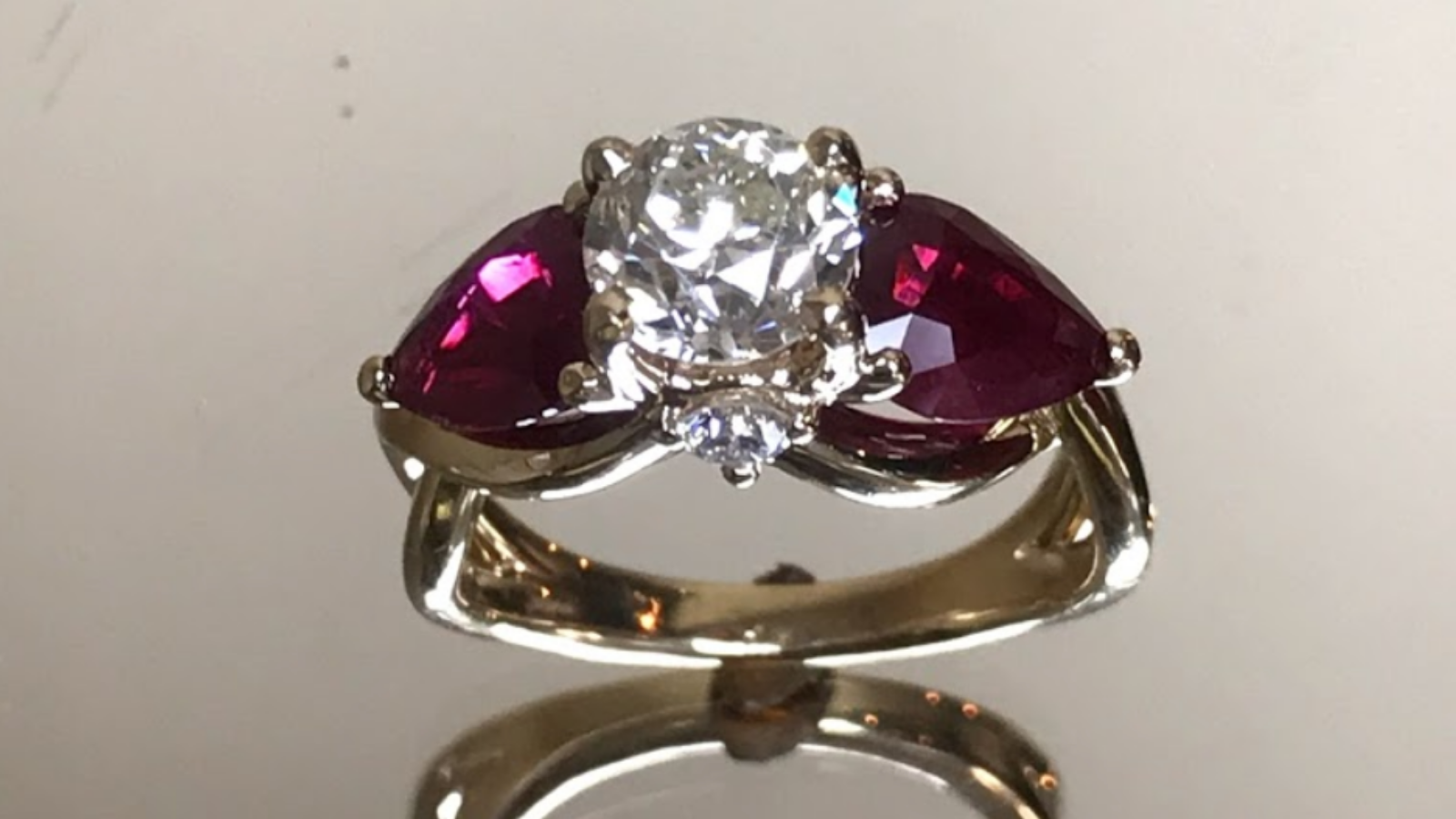 custom ring created by Lisa Marie Kotchey sitting on a reflective surface