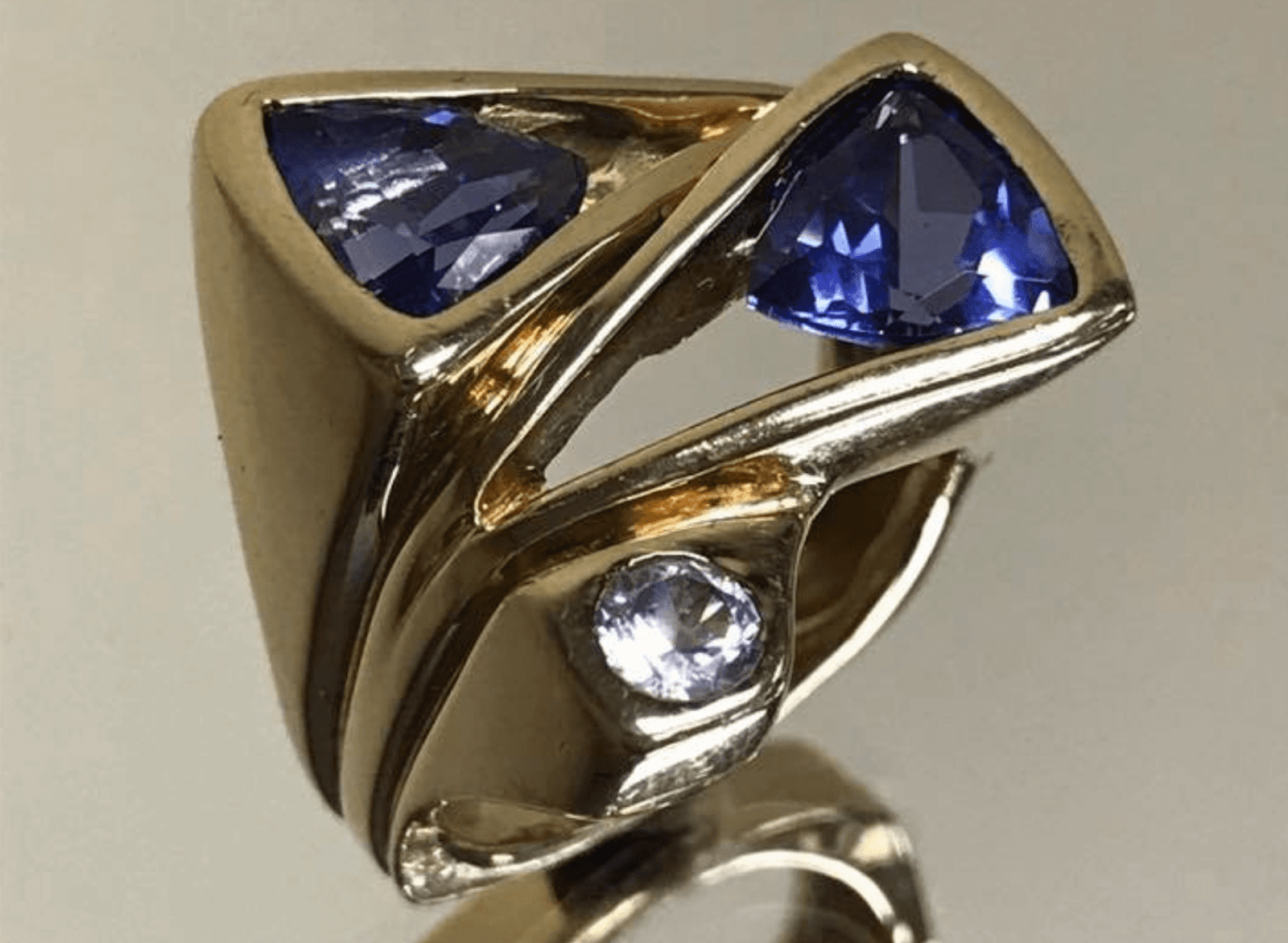 gold ring with blue jewels