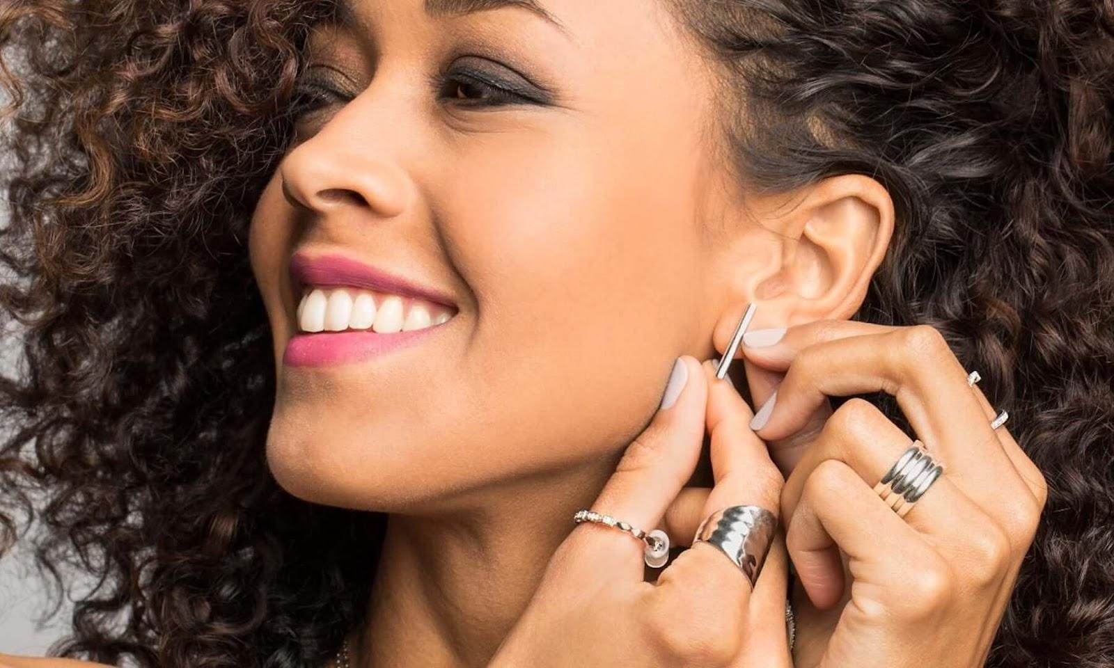 woman touching her earring