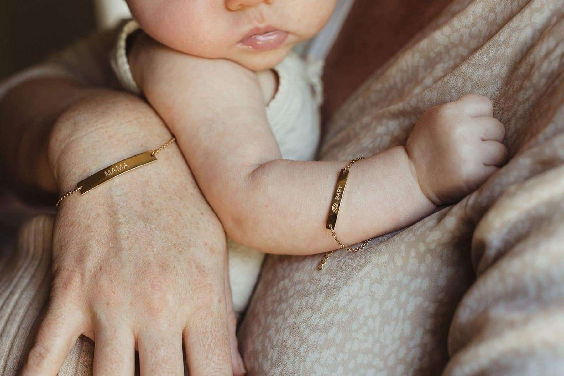 mother and her baby wearing matching bracelets