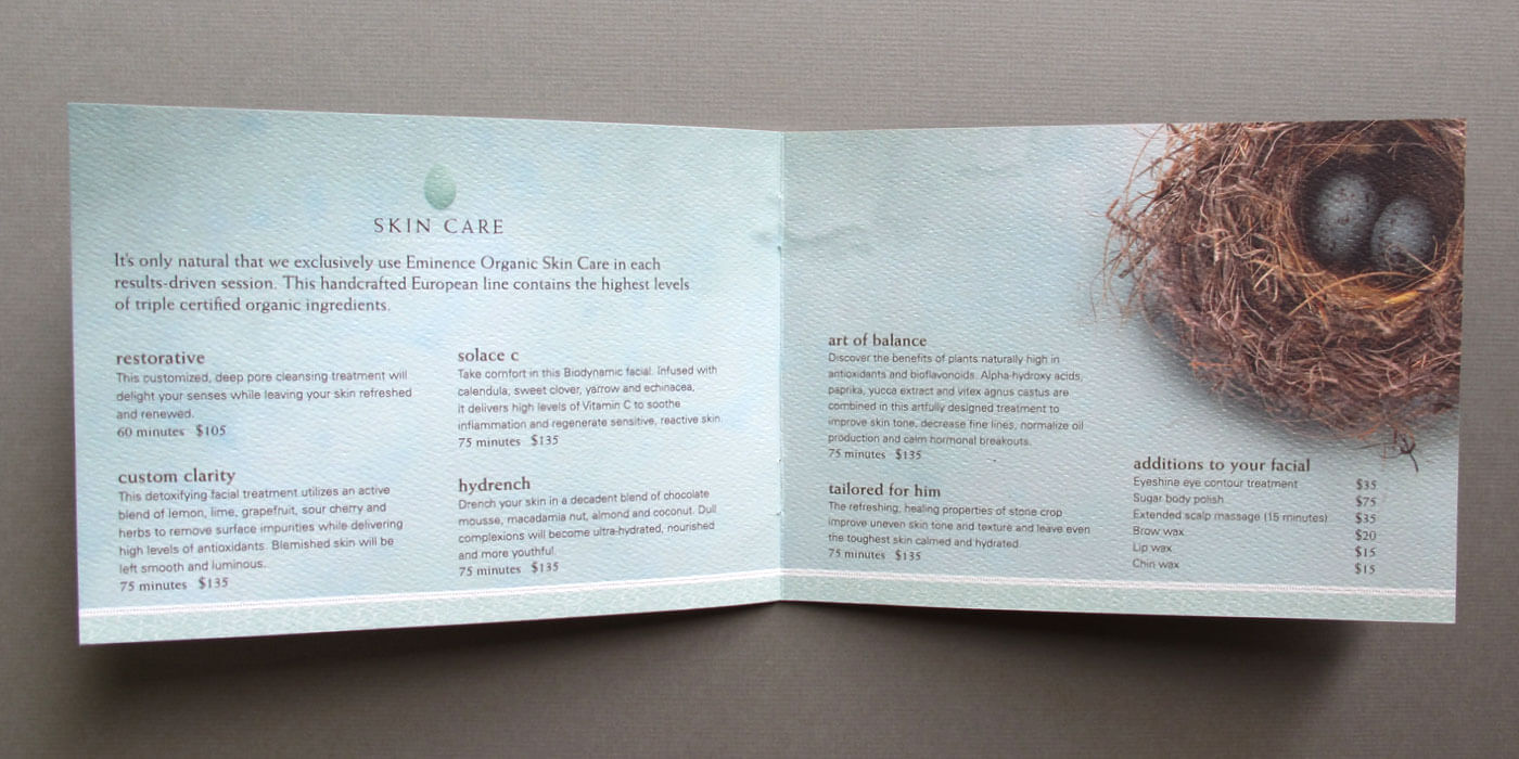 Sparrow Spa massage and day spa menu center spread with list of services printed on a textured paper.