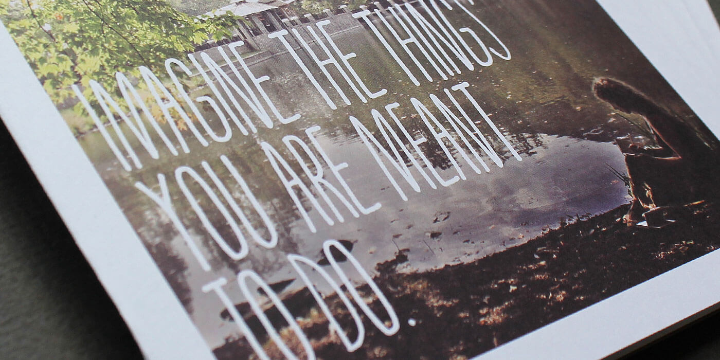 "Montreat College direct mail piece cover detail of woman writing near lake. Headline reads: ""Imagine the things you are meant to do."""