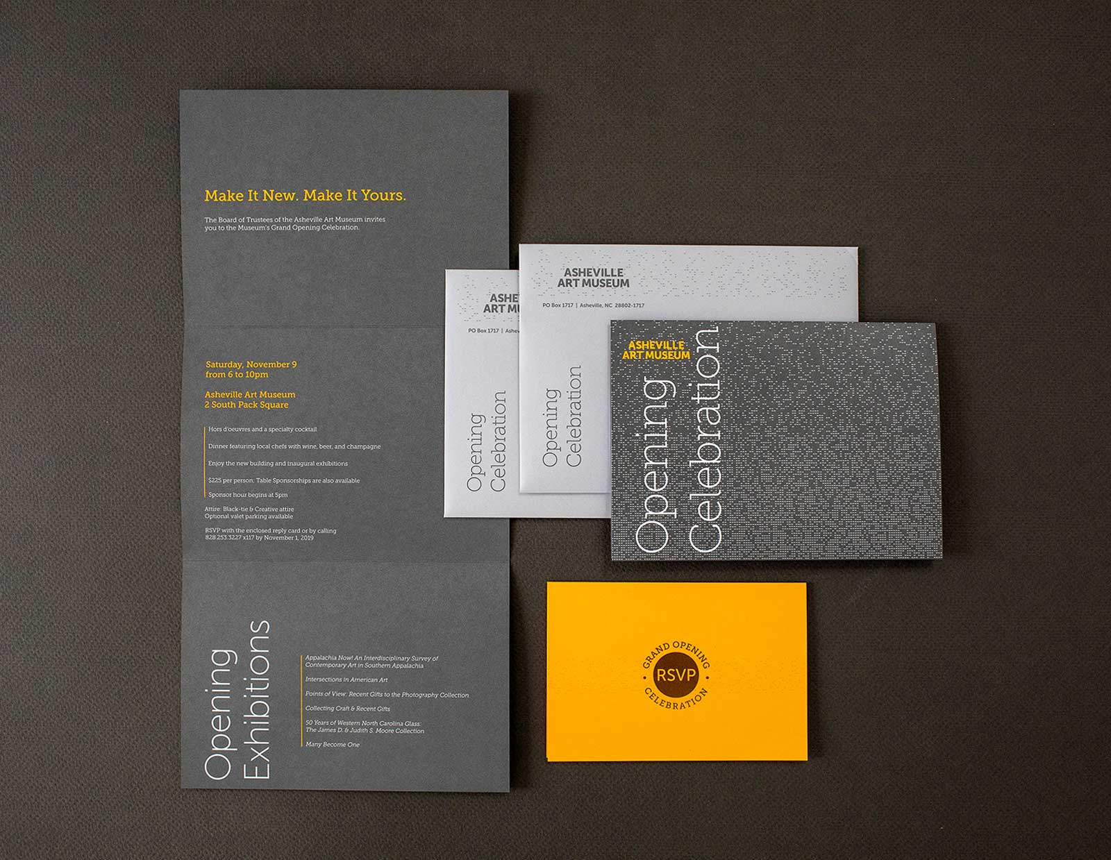 Opening invitation set for the Asheville Art Museum includes invite, envelope, reply card and reply envelope. Two-color design with gray background and gold and white type.