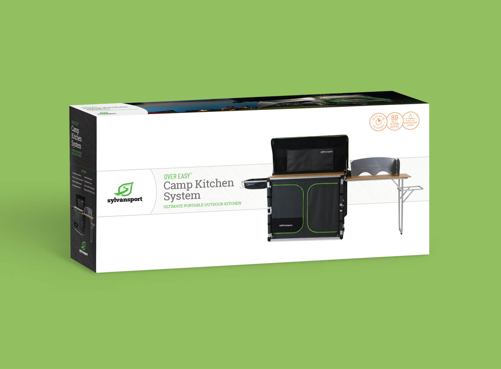 The front of Sylvan Sport packaging box for Camp Kitchen System against green background. Shows image of the product against a white background.