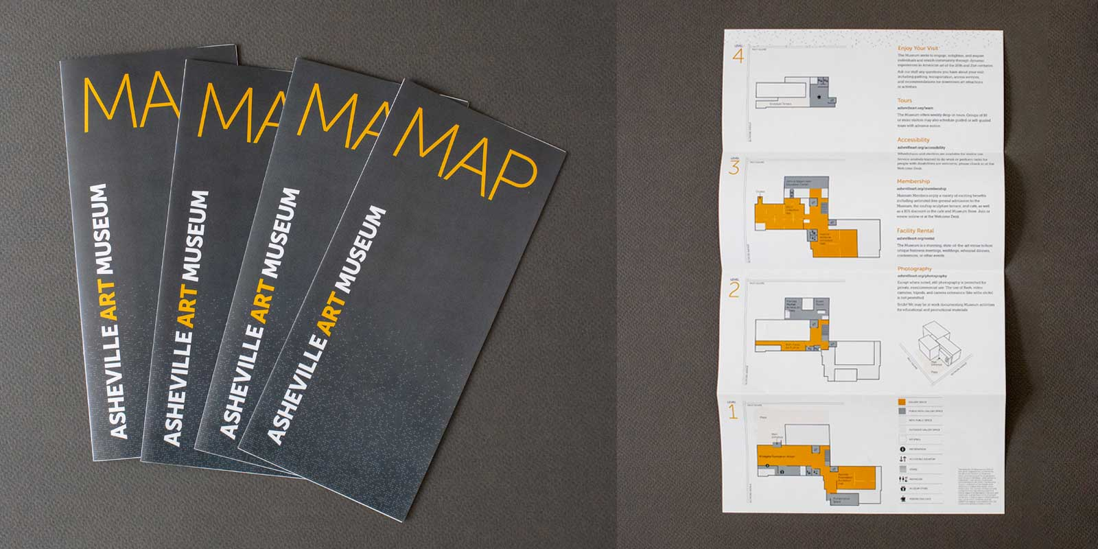 Asheville Art Museum map brochures fanned out against a gray background. Open brochure shows map for each of four levels of the museum.