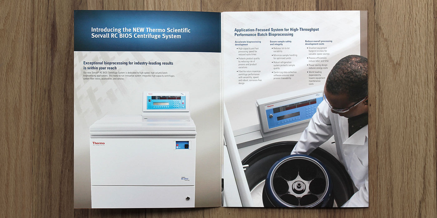 Unfolded Thermo Fisher Scientific brochure for Bios centrifuge system. Male scientist with blue gloves holds Thermo Fisher Scientific FiberLite carbon fiber rotor for centrifuge.